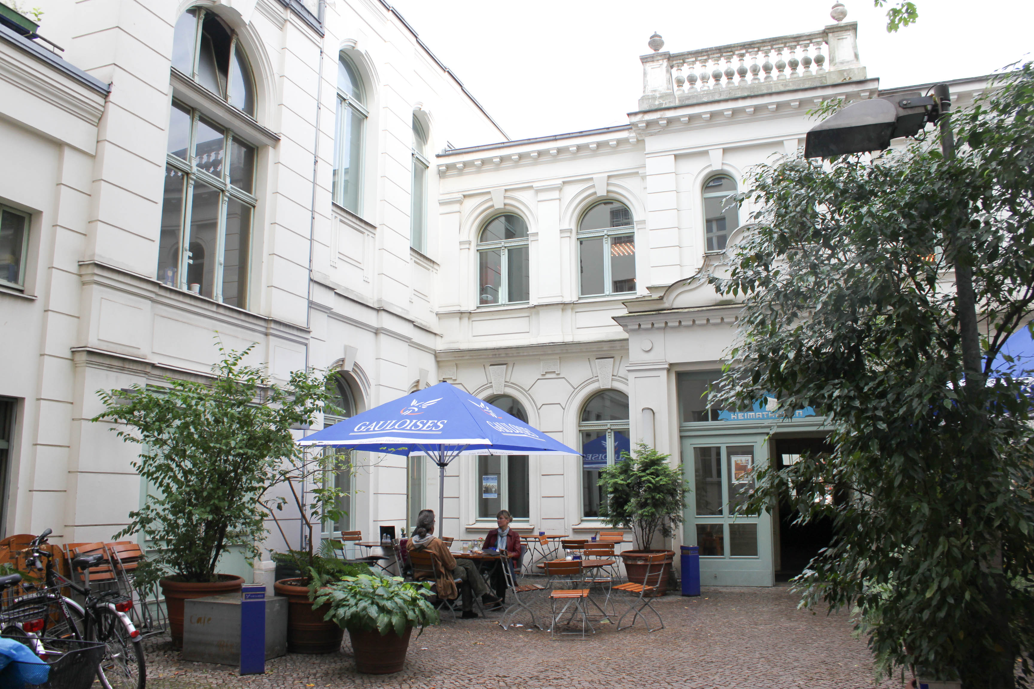Cafe rix in neukölln is housed in a building which once acted as a ballroom it was restored and transformed into a cafe in the 1980s yet the idea of old